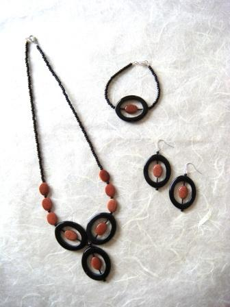 Black agate and goldstone necklace, earrings and bracelet - click to enlarge on a new page